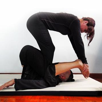 Isha Olsen-Wells performing Lumbar Rock Stretch at TMC 2013