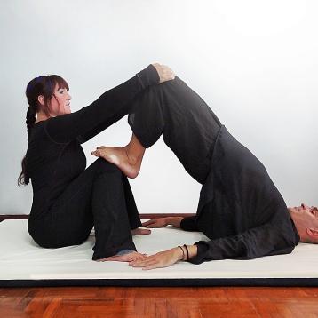 Isha Olsen-Wells performing Shoulder Stand at TMC 2013