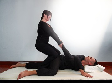 Isha Olsen-Wells performing Spinal Twist at TMC 2013