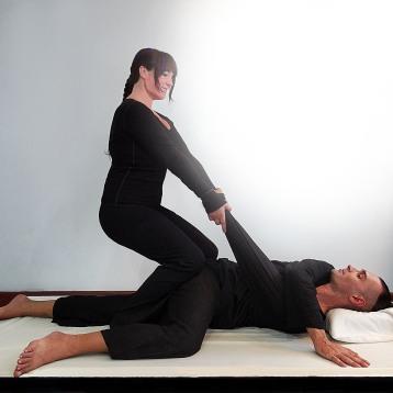 Isha Olsen-Wells performing Spinal Twist at TMC 2013