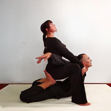 Isha Olsen-Wells performingTotal Spinal Stretch at TMC 2013